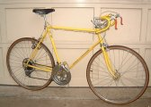 "A banana yellow Schwinn Continental ""Racing"" 10 speed."