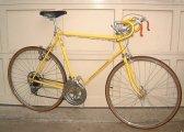 """A banana yellow Schwinn Continental """"Racing"""" 10 speed."""